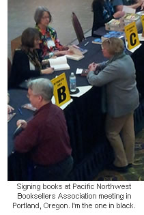 Signing books at PNBA 2013